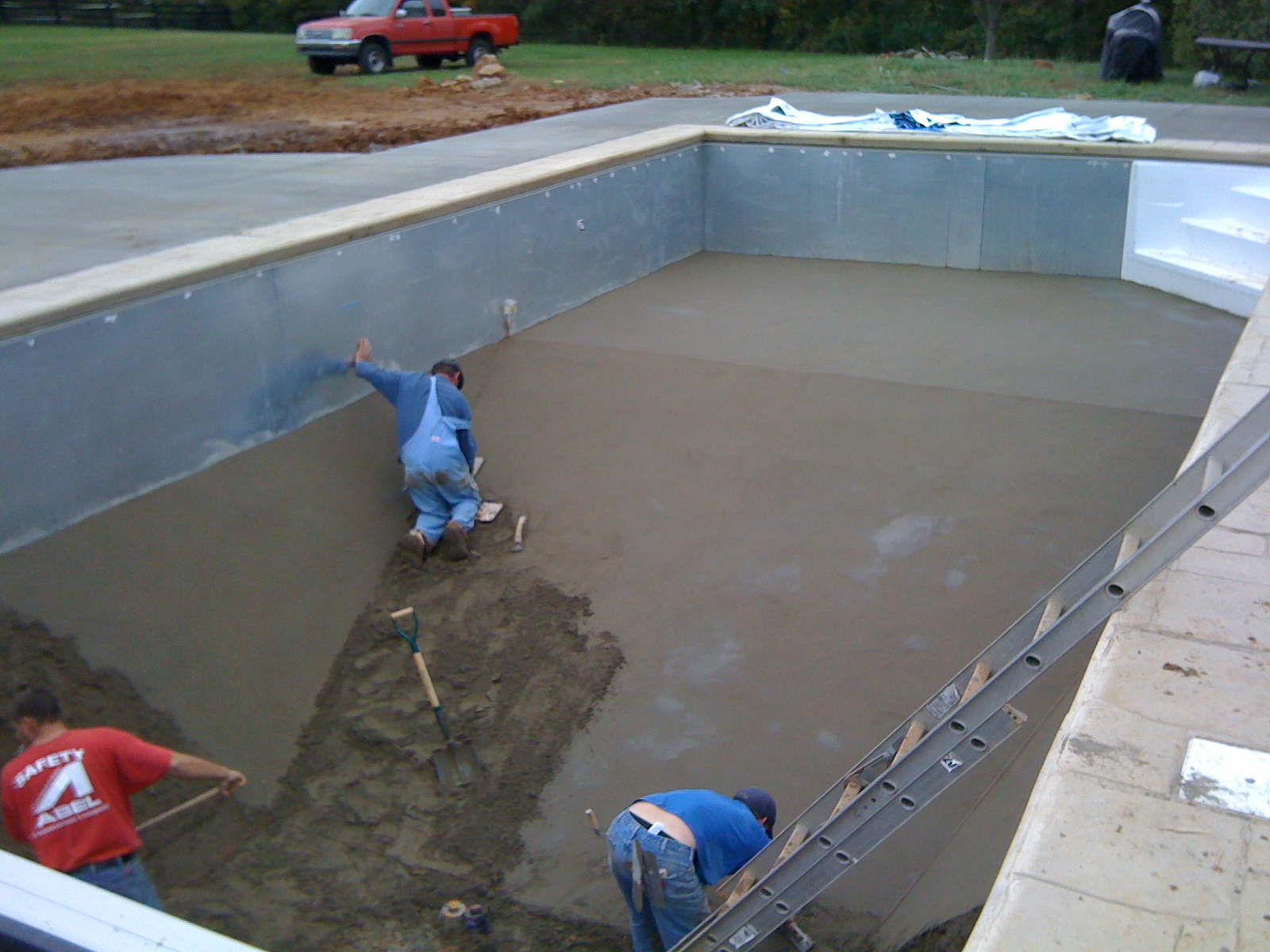 Near the end of putting in the pool bottom.